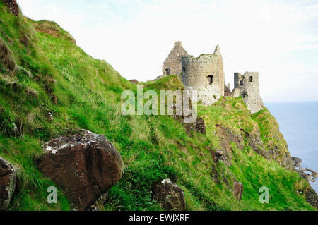 Dunluce Castle is a now-ruined medieval castle in Northern Ireland. County Antrim. United Kingdom, UK - Stock Photo
