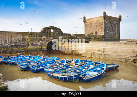 Blue fishing boats in the harbour of Essaouira, Morocco Morocco, Africa - Stock Photo