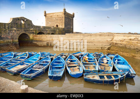 Blue fishing boats in the harbour of Essaouira, Morocco - Stock Photo