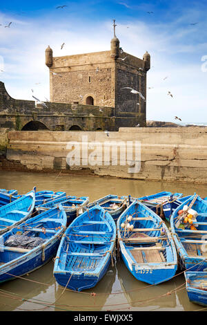 Blue fishing boats in the harbour of Essaouira, Morocco, Africa - Stock Photo