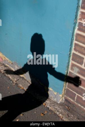 boy's shadow on wall