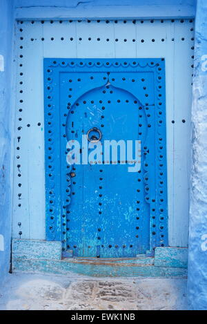 Blue painted door in old medina of Chefchaouen, Morocco, Africa - Stock Photo