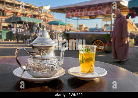 Moroccan green mint tea served in Djemaa el-Fna Square, Marrakesh, Morocco, Africa - Stock Photo
