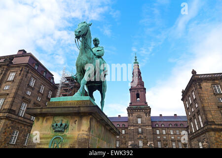 Christiansborg Castle and the Equestrian statue of King Christian IX in the center of Copenhagen, Denmark. - Stock Photo