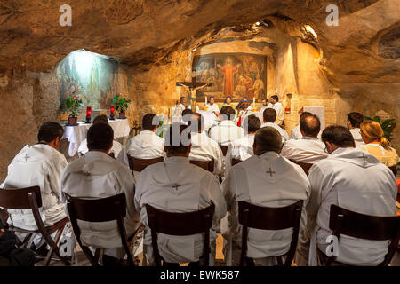 Franciscan monks at the mass in Grotto of Gethsemane in Jerusalem, Israel. - Stock Photo