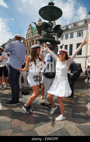 Danish students celebrate their high school graduation. Two very happy girls in front of the Stork Fountain (Storkespringvandet) - Stock Photo