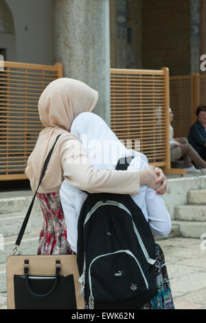 the hug between two Muslim girls in Sarajevo - Stock Photo