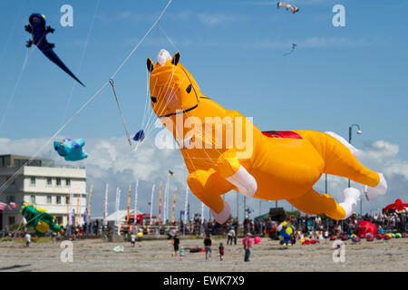 Morecambe, Lancashire, UK 27th June, 2015. Inflatables horse kite at the Catch The Wind Kite Festival an annual event on Morecambe seafront, when for the whole day the skies are full of the most spectacular shapes, colours and creations.  Featured were single line kites of all kinds and sizes and plus 2-line and 4-line stunt kites. Stock Photo