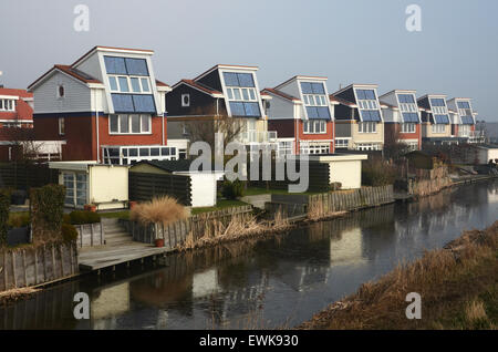 domestic houses with integrated solar panels generating electricity ...