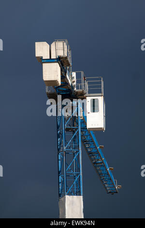 Construction site with crane on sky background - Stock Photo