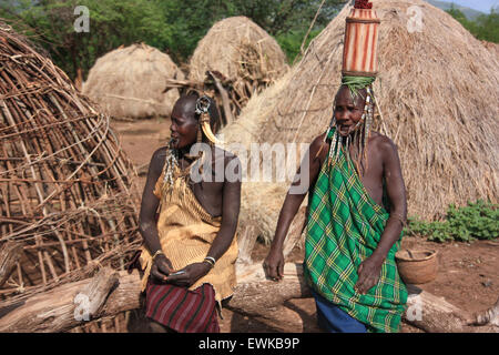 Mursi women in a village - Stock Photo