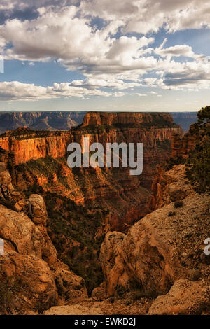 Late afternoon clouds float past Wotans Thorne and Cape Royal along the North Rim of Arizona's Grand Canyon National - Stock Photo