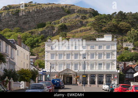 The Empire hotel nestling under the rocks of the Great Orme in Llandudno. Clwyd North Wales. - Stock Photo