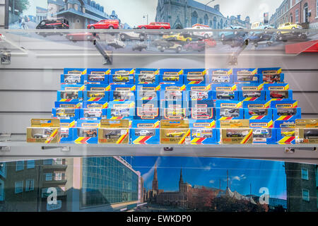 Vintage Matchbox cars on display in a case - Stock Photo
