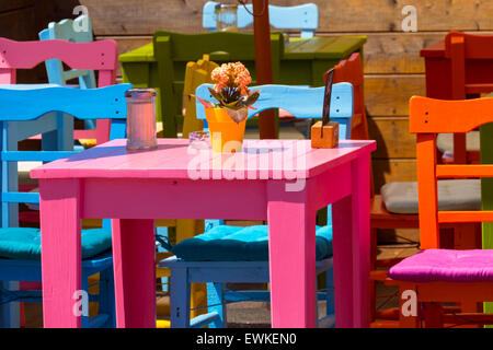 Colourful tables and chairs in a cafe on the harbor, Lindau, Bavaria, Germany, Europe - Stock Photo