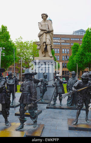 Statue of Rembrandt surrounded by figures from his painting The Night Watch standing in Rembrandtplein in Amsterdam - Stock Photo