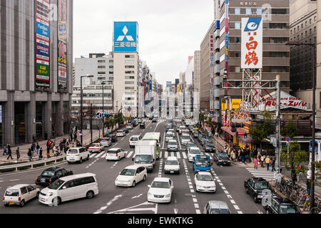 Japan, Osaka, Umeda. Overhead view of main street outside Osaka station in Umeda, busy with lots of traffic - Stock Photo
