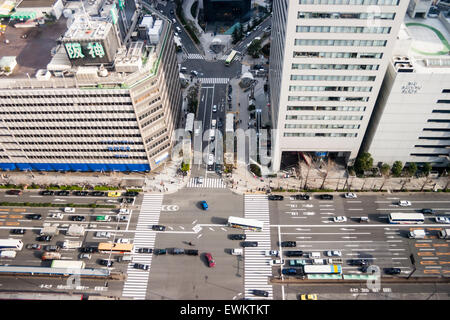 Japan, Osaka, Umeda. Looking directly down at busy street between the Umeda Hilton Hotel and Hanshin department - Stock Photo