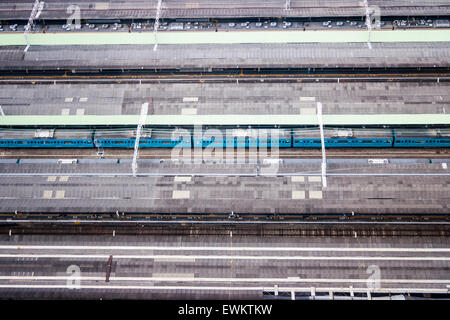 Japan, Osaka, Umeda. Osaka station, platforms, train and tracks viewed from directly above before the new station - Stock Photo
