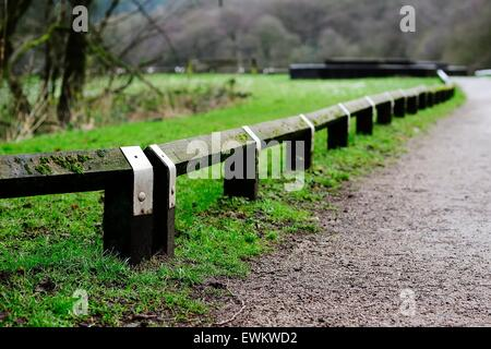 Wooden Knee Rails on the Footpath Edge - Stock Photo