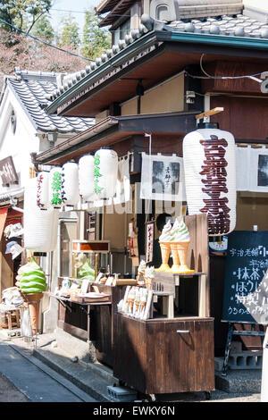 Japan, Kyoto, Arashiyama. A row of small traditional wooden souvenir shop selling various hand crafts and ice creams. - Stock Photo
