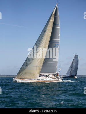 UK. 27th June, 2015. Grand Soleil 56 yacht 'Shine' (nearer) owned by Giles Redpath, and Imoca 60 'J P Morgan Asset - Stock Photo