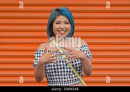 A young Woman with exceptionally long fingernails at Coney Island, Brooklyn, New York. - Stock Photo