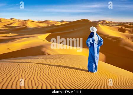 Berber man, Erg Chebbi desert near Merzouga, Sahara, Morocco - Stock Photo