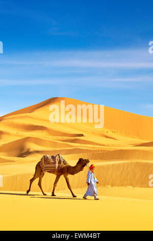 Berber man with his camel, Erg Chebbi desert near Merzouga, Sahara dunes, Morocco - Stock Photo
