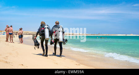 Divers after diving, Marsa Alam, Abu Dabbab Bay, Red Sea, Egypt - Stock Photo