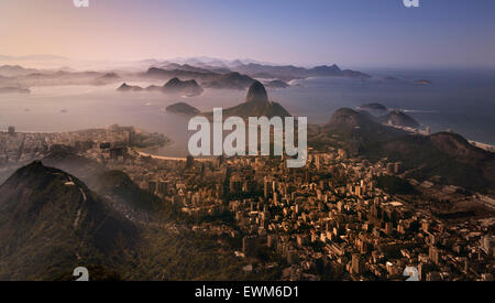 The view from Christ the Redeemer (Cristo Rendentor) atop Mount Corcovado towards Sugarloaf in Rio de Janeiro, Brazil - Stock Photo