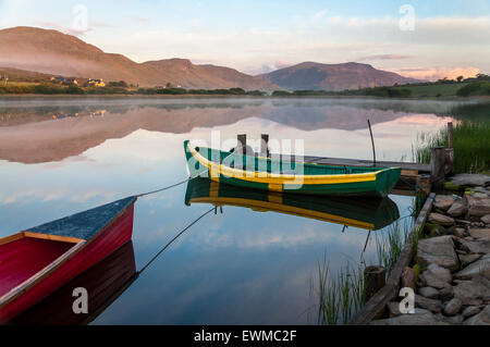 Boats on a misty morning on Lake Shanaghan, Ardara, County Donegal, Ireland - Stock Photo