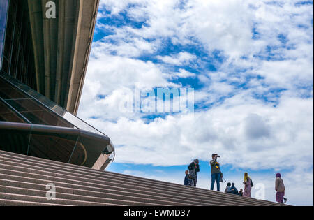 Australia, Sydney, tourists on the flight of steps of the Opera House - Stock Photo