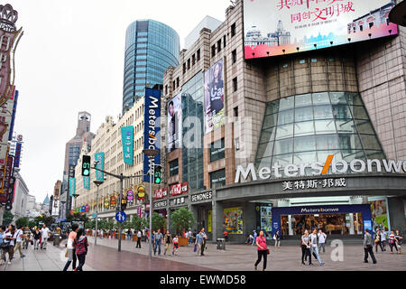 Visitors at Nanjing Road. Main shopping street of Shanghai. One of the busiest shopping streets in the world .  - Stock Photo