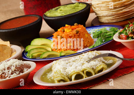 Stock image of traditional mexican green enchilada dinner - Stock Photo