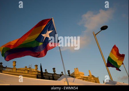 A flag with the rainbow colors and the star (symbol of Catalan independence) flies in the wind on the occasion of - Stock Photo