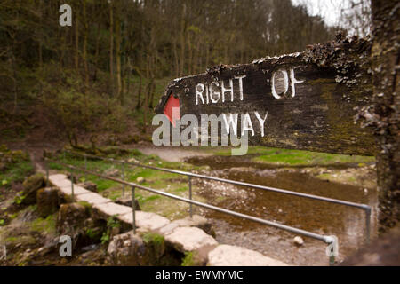 UK, England, Derbyshire, Over Haddon, right of way footpath sign at footbridge over River Lathkill Dale Nature Reserve - Stock Photo