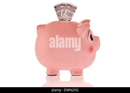 Stuffed piggy bank isolated on white with lots of bills in slot.  On white background. - Stock Photo
