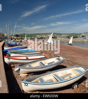 Boats on Shaldon beach, looking towards Teignmouth. - Stock Photo
