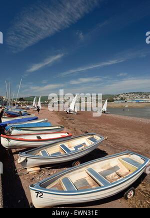 Boats on Shaldon beach, looking towards Teignmouth. - Stock Photo