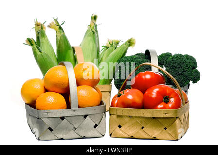 Baskets full of fresh and healthy fruits and vegetables isolated on white. - Stock Photo