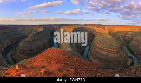San Juan River meanders at sunrise at Goosenecks State Park Utah, USA. - Stock Photo