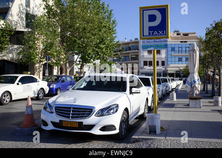 A full quota of taxis awaiting a fare on Rethymnon taxi rank. - Stock Photo