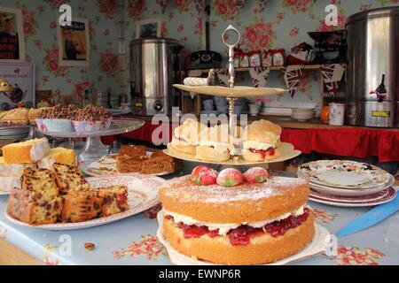 Tea and cakes at a pop-up tea room at a traditional British summer festival, Bakewell, Peak District, Derbyshire - Stock Photo