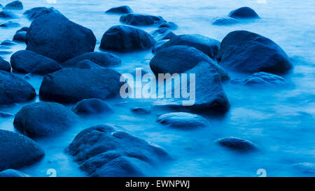 stones in water at blue hour near lohme on rugen, mecklenburg-vorpommern, germany - Stock Photo