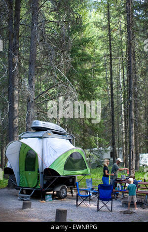 Family camping in new, lightweight travel trailer - Stock Photo
