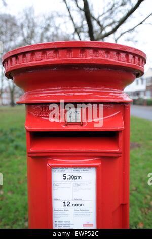 A red Royal Mail post box. - Stock Photo