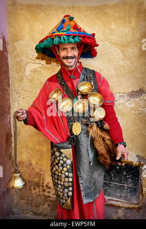 Portrait of moroccan water seller in traditional dress, Marrakech Medina. Morocco - Stock Photo