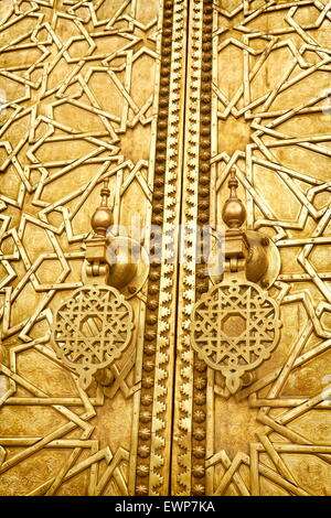 Fez, Royal Palace (Jdid Dar El Makhzen), closeup of ornate carved brass door. Morocco - Stock Photo