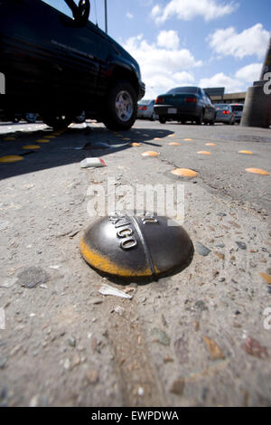Border marker between USA and Mexico - Stock Photo